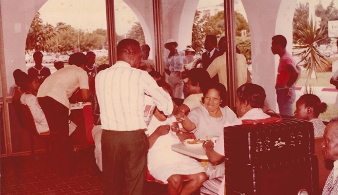 Customers dining in at the opening of Kentucky Fried Chicken