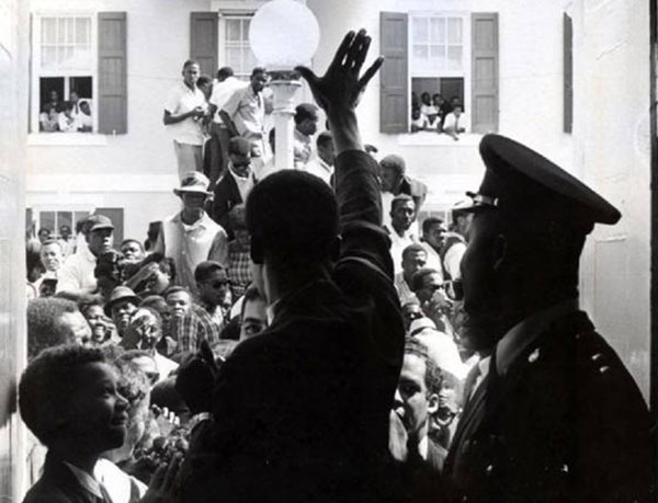 Lynden Oscar Pindling waves to the crowd after the 1967 election