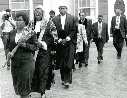 Lynden Pindling walking with Judges of the Courts and Speaker of the House of Assembly.